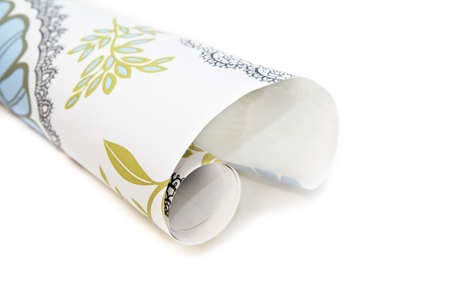 roll: roll of wallpaper with ornaments over white