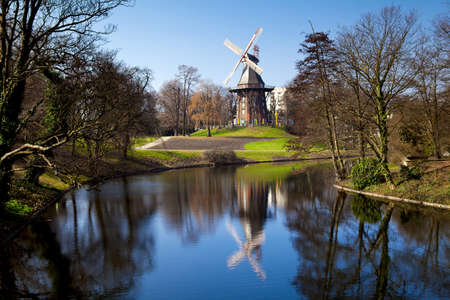 windmill and its reflection in lake in Bremen, Germany