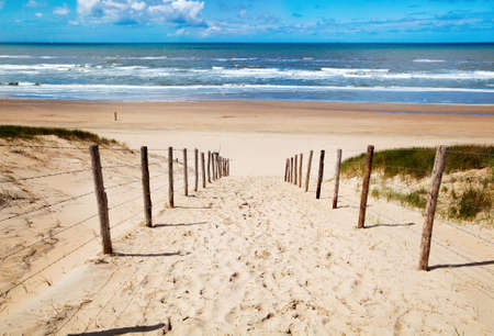 way to the sand beach on North sea in Netherlands Stock Photo