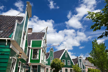green traditional buildings in small Dutch town Zaanse Schans Stock Photo