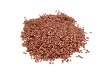 common flax: many seeds of common flax on white background