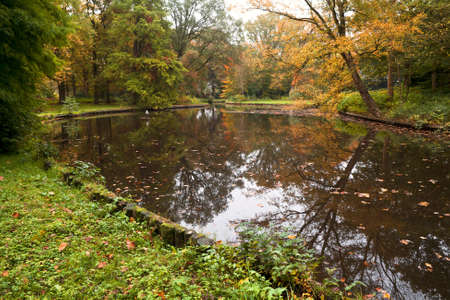 groningen: cozy pond and colorful trees in autumn, Groningen, Netherlands Stock Photo