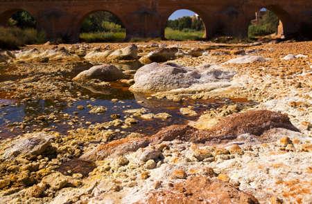acidic: bridge over acidic rio (river) Tinto in Niebla (Huelva), Spain