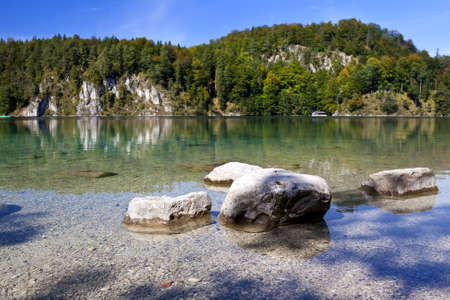 stones in clear Alpsee lake, Bavaria, Germany