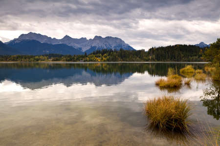 autumn clouded and rainy weather on Barmsee lake, Germany