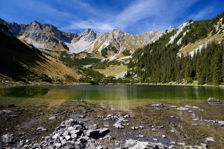 sunny Soiernsee lake and mountain pick Schottelkarspitze in Alps, Bavaria photo