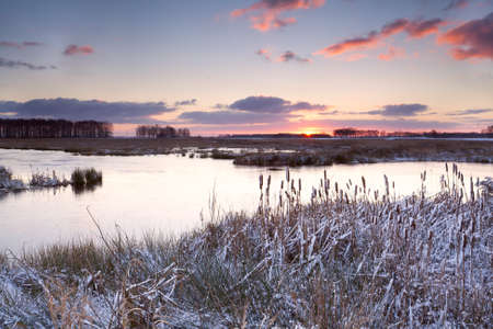 sunrise over lake with snow and ice by Leekstermeer in winter Stock Photo - 16855693