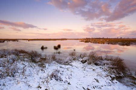 sunrise over frozen lake at winter Stock Photo - 16892146