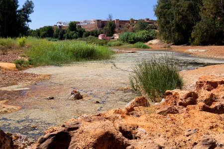 acidic: acidic river Tinto in Niebla (Huelva), Spain Stock Photo