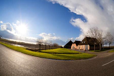bright sunbeams over Dutch farmhouse, fisheye view Stock Photo - 17062553