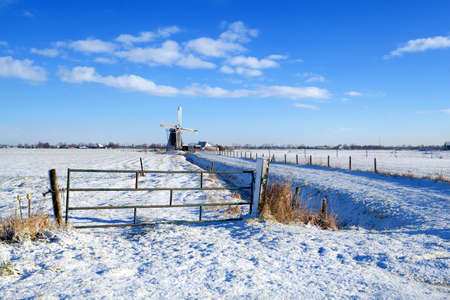 traditional Dutch windmill in snowy winter Stock Photo - 17147299
