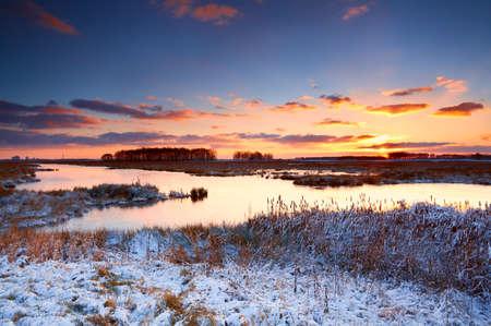 colorful sunrise over river in winter Stock Photo - 17229945