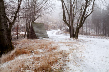 wooden hut: wooden hut in winter mountains during snowstorm