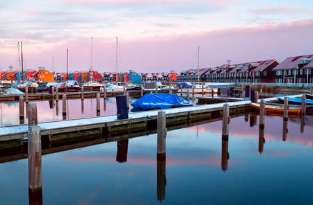 marina with many piers and yachts at Reitdiephaven during sunrise Stock Photo - 17424345