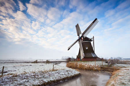 cloudscape over Dutch windmill in Groningen Stock Photo - 17424348