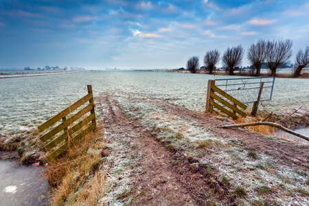 wooden fence on winter pasture at sunrise  Stock Photo - 17424363