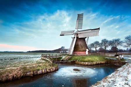 Dutch windmill in winter after sunset photo