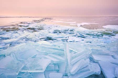 ijsselmeer: big broken ice pieces at sunset on North sea, Ijsselmeer Stock Photo