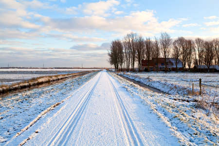 Dutch farmhouse in snowy winter by road Stock Photo - 17900789