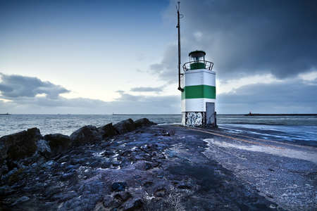 lighthouse by North sea in IJmuiden, Netherlands photo