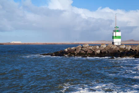white and green lighthouse in North sea, Netherlands Stock Photo - 17900863