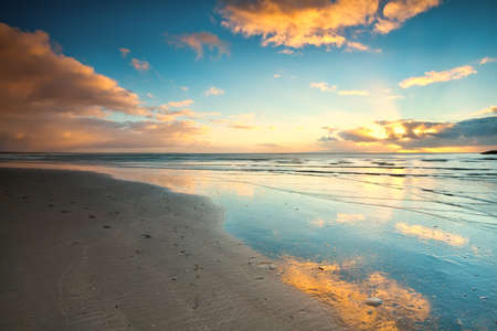 sunset over beach at North sea in Netherlands Stock Photo