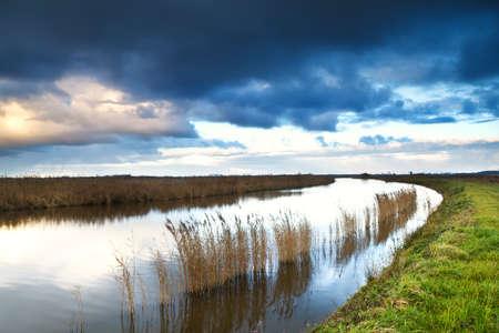 groningen: cloudscape over river in Groningen, Netherlands Stock Photo
