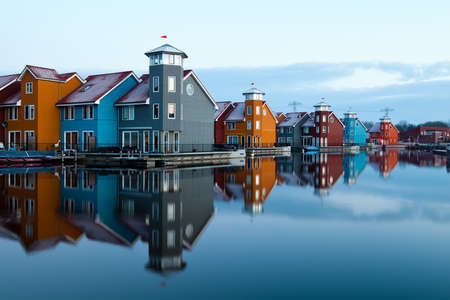 colorful buildings on water at Reitdiephaven in Groningen, Netherlands