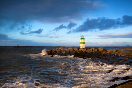 green lighthouse on North sea, Ijmuiden before sunset photo