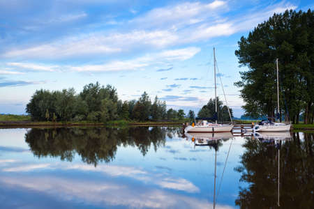 two yachts on calm river at early morning Stock Photo - 18790875