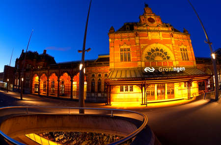 Central Station and underground bicycle parking in Groningen in dusk