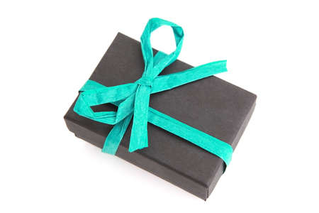 beautifully wrapped: beautifully wrapped black and blue gift box over white background