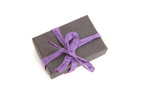 decorated black and violet gift box over white background photo