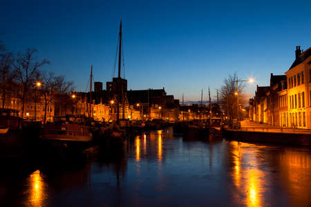 ship on canal in Dutch city at night, Groningen photo