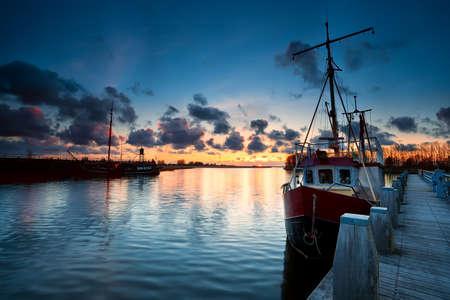fishing boat: fishing ships at sunset in Zoutkamp, Netherlands Stock Photo