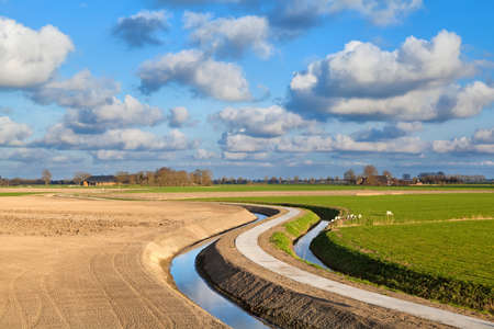 rural curved road for bikes in Dutch farmland, Holland Stock Photo - 19457820