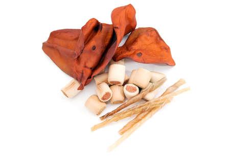 crocket: dry treats as pork ears, sticks, chews for dogs over white