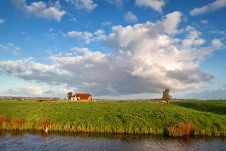 charming farmhouse and beautiful sky, Groningen, Netherlands photo