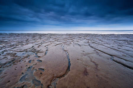 low tide: texture on mud at low tide of North sea, Moddergat, Netherlands Stock Photo