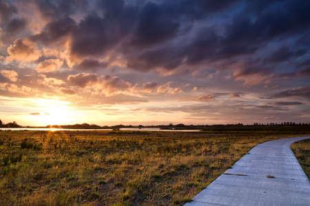 beautiful cloudscape at warm dramatic sunset photo