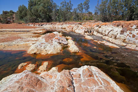 acidic: orange stones in acidic rio Tinto, Niebla (Huelva), Spain