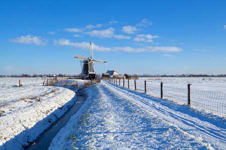 Dutch windmill during snowy winter, Groningen, Netherlands photo