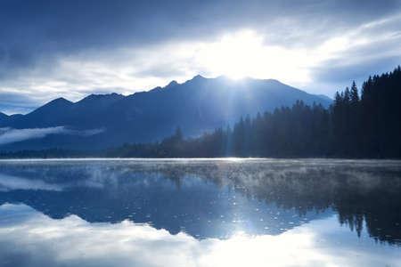 morning sunshine over Karwendel mountain range and Barmsee lake Banco de Imagens