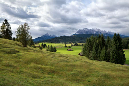 sulight: green alpine meadows and Karwendel mountains in Bavaria