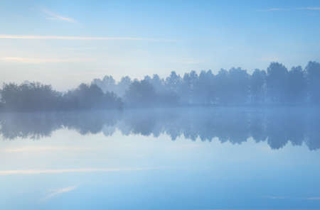 tranquil misty morning on wild lake Stock Photo
