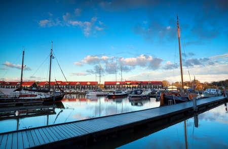 groningen: yachts and boats at marine Reitdiephaven before sunset, Groningen, Netherlands