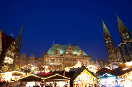 City Hall, Bremen Cathedral and Christmas market in Bremen by night, Germany Stock Photo