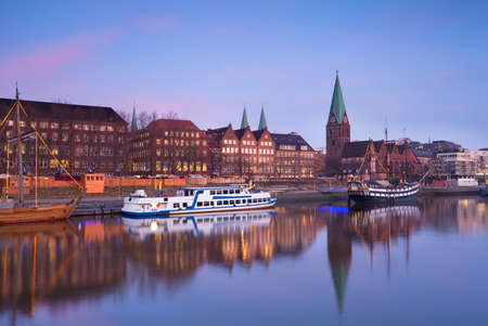 pink sunset over river in Bremen city, Germany