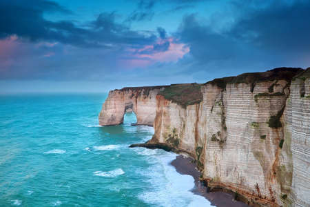 rocky cliff in azure ocean waves, Etretat, Normandie, France photo