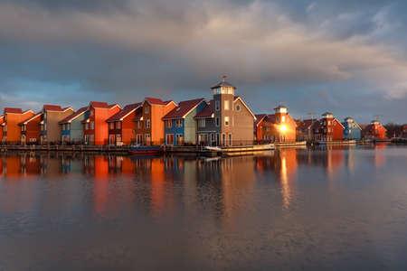 groningen: colorful buildings on water  in morning sunshine, Groningen, Netherlands Stockfoto